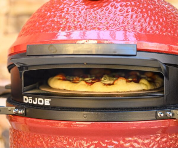 Kamado Joe - Classic 3 Pro DoJoe Pizza Bundle - The Kamado Joe Classic III includes the newest innovation, the revolutionary SloRoller Hyperbolic Smoke Chamber insert. Harnessing the power of cyclonic airflow technology to control heat and smoke, the SloRoller insert is designed to perfect the taste and texture of food on low-and-slow cooks up to 500F, and is easily swapped out for heat deflector plates when searing or grilling at higher temperatures. As with its predecessor, the Classic II, it also features a thick-walled, heat-resistant shell that locks in smoke and moisture at any temperature. RRP price £2680.65 Bundle Price £2412.00 <em><strong>Bundle Saving £268.65 + FREE T-shirt worth £25!</strong></em>  *Free next day delivery is available Monday - Friday (excluding Bank Holidays) on orders placed before 2pm. Any orders placed after this time will be processed and dispatched the following working day.